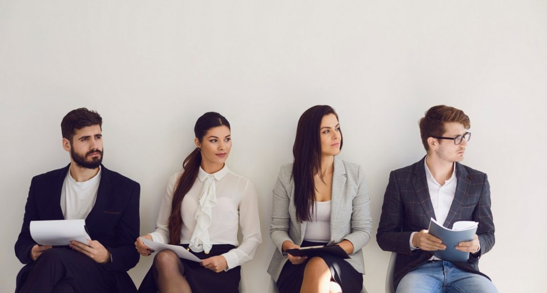 Business people waiting for job interview recruitment sitting on a chair in the office. Employee office worker people recruitment concept.